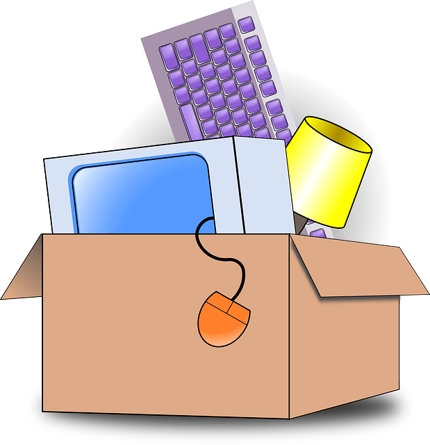 Moving box with a monitor, mouse, keyboard and lamp in it