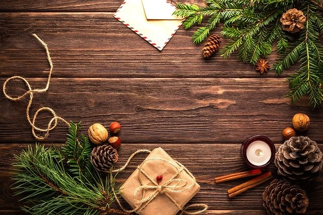 Christmas decorations and gifts on a wooden surface.