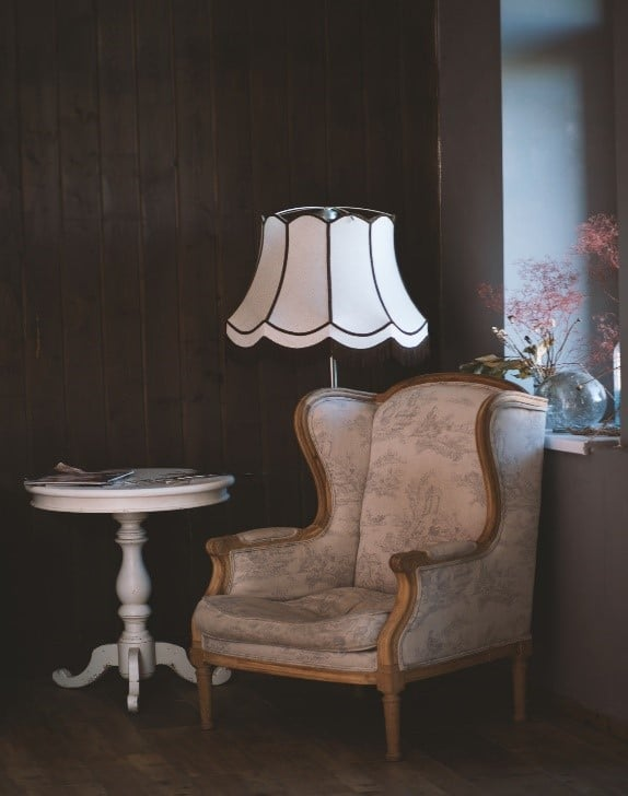 A stylish armchair, a lamp and a coffee table
