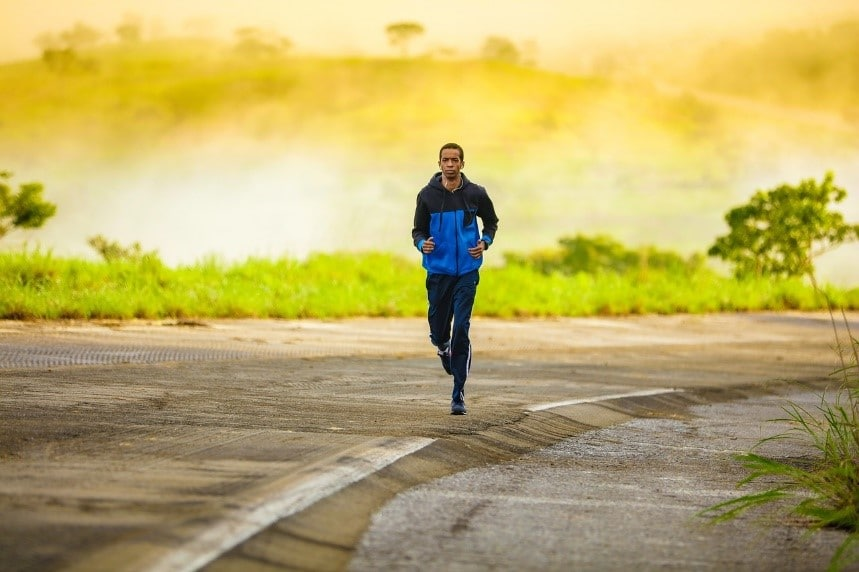 A man jogging and showing a proper way to stay fit and healthy during your move