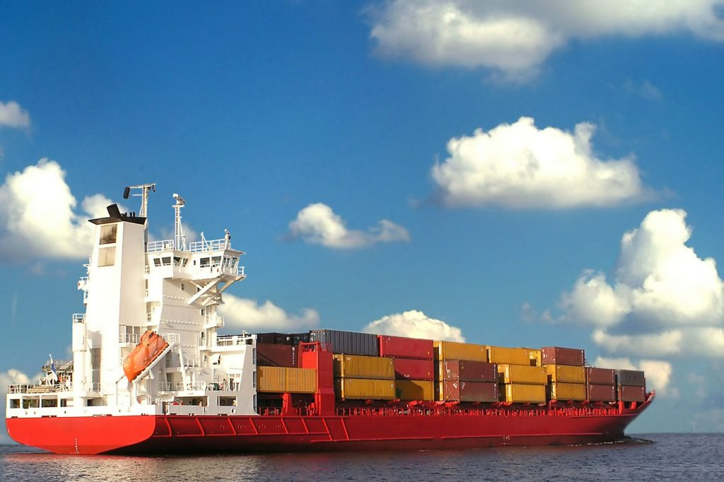 a boat shipping freight containers